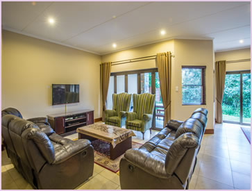 The lounge at Zimbali Holiday Home's Baluwatu villa has luxury leather recliner couches and a high definition 3D TV with DSTV