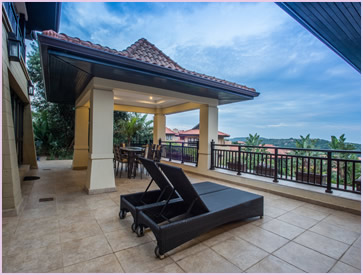 Covered balcony area in the frontyard of Zimbali Holiday Home's Acaciawood villa, which has a beautiful view of the Indian Ocean