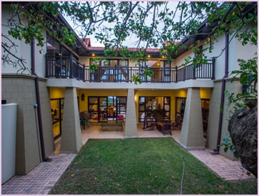 The Zimbali Holiday Home's Acaciawood unit has a patio in the backyard, which is perfect for a braai/barbeque